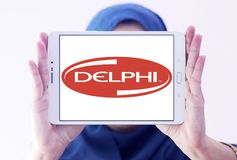 Delphi Technologies logo. Logo of Delphi Technologies on samsung tablet holded by arab muslim woman. The company provides combustion systems, electrification Stock Photos