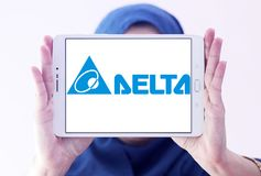 Delta Electronics company logo. Logo of Delta Electronics company on samsung tablet holded by arab muslim woman. it is one of the world`s leading producer of royalty free stock image