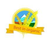 Logo des Weizens und der Berge mit dem Aufschrift ` am besten im organischen ` Stockfotos