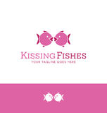 Logo design of 2 iconic fishes kissing. For dating site or Royalty Free Stock Photos