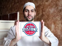 Detroit Pistons american basketball team logo. Logo of Detroit Pistons team on samsung tablet holded by arab muslim man. The Detroit Pistons are an American Stock Photography