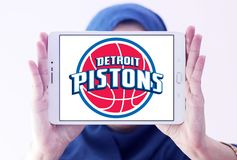 Detroit Pistons american basketball team logo. Logo of Detroit Pistons team on samsung tablet holded by arab muslim woman. The Detroit Pistons are an American Stock Photos