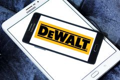 DeWalt company logo. Logo of DeWalt company on samsung mobile. DeWalt is an American worldwide brand of power tools and hand tools for the construction Stock Photo