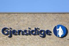 Logo di Gjensidige su una parete fotografie stock libere da diritti