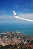 Logo di Malaysia Airlines sull'ala dell'aeroplano Fotografia Stock Libera da Diritti