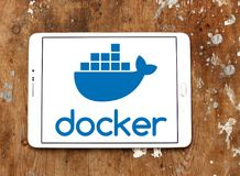 Docker software company logo. Logo of Docker software company on samsung tablet. Docker is a computer program that performs operating system level virtualization royalty free stock photo