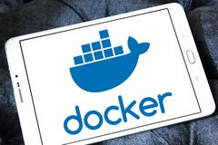 Docker software company logo. Logo of Docker software company on samsung tablet. Docker is a computer program that performs operating system level virtualization stock images
