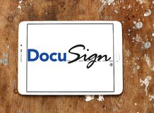 DocuSign company logo. Logo of DocuSign company on samsung tablet on wooden background. DocuSign provides electronic signature technology and digital transaction Stock Photos