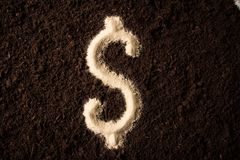 Logo dollar symbol writing sand on the dirt background Royalty Free Stock Images