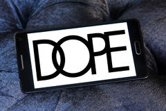 Dope brand logo. Logo of Dope brand on samsung mobile. Dope is a street wear brand. The clothing line is available in boutiques worldwide royalty free stock photo