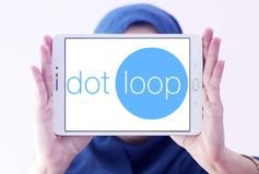 Dotloop logo. Logo of dotloop on samsung tablet holded by arab muslim woman. dotloop is a transaction system that allows the paperwork associated with a Stock Photo