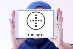 The dots social network logo. Logo of the dots social network on samsung tablet holded by arab muslim woman stock photo