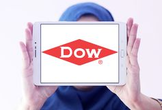 Dow Chemical Company logo. Logo of Dow Chemical Company on samsung tablet holded by arab muslim woman. Dow Chemical is an american multinational chemical Royalty Free Stock Photography