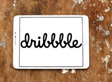 Dribbble online community logo. Logo of Dribbble on samsung tablet. Dribbble is an online community for showcasing user made artwork. It functions as a self stock images