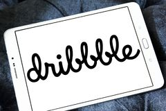 Dribbble online community logo. Logo of Dribbble on samsung tablet. Dribbble is an online community for showcasing user made artwork. It functions as a self Stock Photo