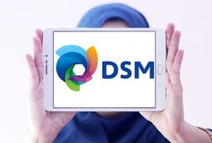 DSM company logo. Logo of DSM company on samsung tablet holded by arab muslim woman. DSM is a Dutch multinational active in the fields of health, nutrition and royalty free stock photography