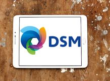DSM company logo. Logo of DSM company on samsung tablet on wooden background. DSM is a Dutch multinational active in the fields of health, nutrition and stock photography