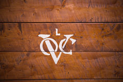 Logo of the Dutch United East India Company. (Vereenigde Oostindische Compagnie) on background of wooden planks. It is often mentioned as the first Stock Image