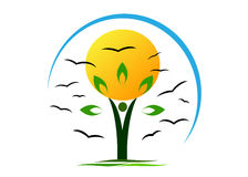 Logo ecology . People in the form of a tree holding the sun, on the background of flocks of birds and sky Stock Photos