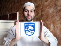 Philips logo. Logo of electronics company philips on samsung tablet holded by arab muslim man Stock Photo
