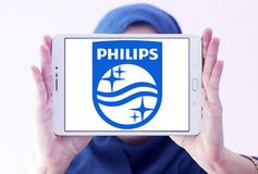 Philips logo. Logo of electronics company philips on samsung tablet holded by arab muslim woman Royalty Free Stock Photos
