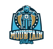 Logo, emblem of the rider riding a mountain bike. Downhill, freeride, extreme sport. Vector illustration. Royalty Free Stock Photography