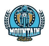 Logo, emblem of the rider riding a mountain bike. Downhill, freeride, extreme sport. Vector illustration. Stock Photos