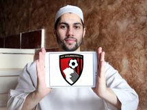 AFC Bournemouth soccer club logo. Logo of english soccer club AFC Bournemouth on samsung tablet holded by arab muslim man Royalty Free Stock Image