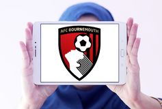 AFC Bournemouth soccer club logo. Logo of english soccer club AFC Bournemouth on samsung tablet holded by arab muslim woman Royalty Free Stock Photography