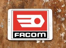 FACOM tools company logo. Logo of FACOM tools company on samsung tablet on wooden background Royalty Free Stock Photos