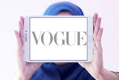Vogue logo. Logo of fashion company, vogue on samsung tablet holded by arab muslim woman Stock Photos