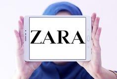 Zara logo. Logo of fashion company zara on samsung tablet holded by arab muslim woman stock images