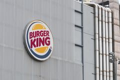 Logo of the fast food chain Burger King outside a restaurant in Italy. LA SPEZIA, ITALY - AUGUST 13, 2018 - Logo of the fast food chain Burger King outside a Stock Photos