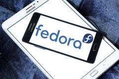 Fedora operating system logo. Logo of Fedora operating system on samsung mobile. Fedora is a Linux distribution developed by Fedora Project and sponsored by Red Stock Image