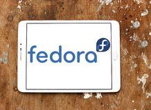 Fedora operating system logo. Logo of Fedora operating system on samsung tablet. Fedora is a Linux distribution developed by Fedora Project and sponsored by Red Stock Photo