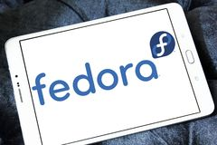 Fedora operating system logo. Logo of Fedora operating system on samsung tablet. Fedora is a Linux distribution developed by Fedora Project and sponsored by Red Royalty Free Stock Photos