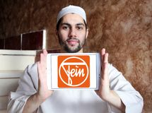Fein company logo. Logo of Fein company on samsung tablet holded by arab muslim man.  Fein GmbH is a manufacturer of high-end power tools Stock Image
