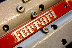 Logo Ferrari on motor of sport car Stock Photos
