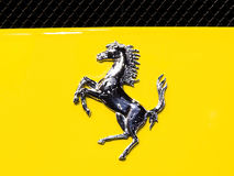 Logo of Ferrari on yellow super sport car Royalty Free Stock Image
