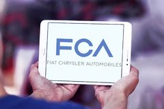 Fiat Chrysler Automobiles, FCA company logo. Logo of Fiat Chrysler Automobiles, FCA company on samsung tablet . FCA is an Italian-controlled multinational stock photography