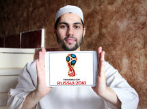 FIFA World Cup Russia 2018 logo. Logo of FIFA World Cup Russia 2018 on samsung  tablet holded by arab muslim man. The 2018 FIFA World Cup will be the 21st FIFA Royalty Free Stock Images