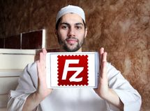 FileZilla application logo. Logo of FileZilla application on samsung tablet holded by arab muslim man. FileZilla is a free software, cross platform FTP Royalty Free Stock Photos
