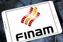 Finam Holdings logo. Logo of Finam Holdings on samsung tablet. Finam Holdings is a financial services company headquartered in Moscow, Russia. It is the parent Stock Photography