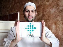 Fitbit company logo. Logo of Fitbit company on samsung tablet  holded by arab muslim man. Fitbit is an American company known for its products of the same name Stock Photography