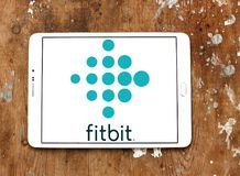 Fitbit company logo. Logo of Fitbit company on samsung tablet on wooden background. Fitbit is an American company known for its products of the same name, which Stock Image