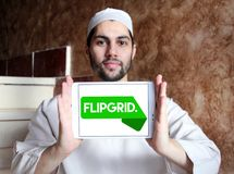 Flipgrid community logo. Logo of Flipgrid community on samsung tablet holded by arab muslim man. Flipgrid is a video discussion community for your classroom that royalty free stock image