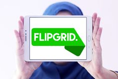 Flipgrid community logo. Logo of Flipgrid community on samsung tablet holded by arab muslim woman. Flipgrid is a video discussion community for your classroom royalty free stock images