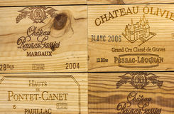 Logo of French winery Chateau Olivier on wooden wine box. Stock Photos