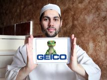 GEICO Insurance Company logo. Logo of GEICO Insurance Company on samsung tablet holded by arab muslim man. GEICO, Government Employees Insurance Company, is an Stock Images