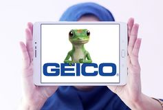 GEICO Insurance Company logo. Logo of GEICO Insurance Company on samsung tablet holded by arab muslim woman. GEICO, Government Employees Insurance Company, is an Royalty Free Stock Images
